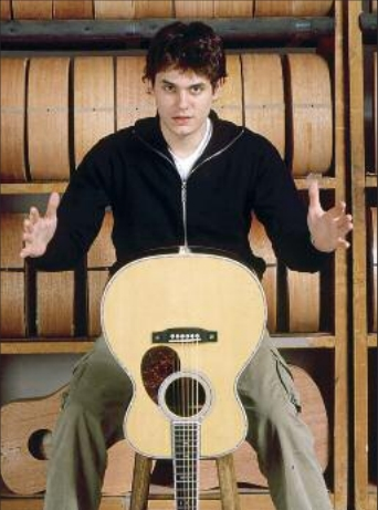 John Mayer pictured with a Martin 00-45SC John Mayer Edition Acoustic Guitar
